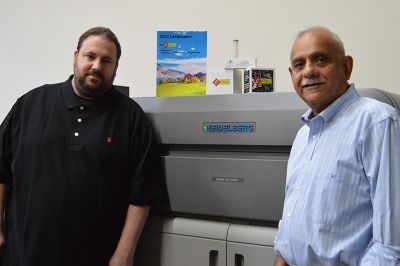 Image includes left to right: Mike Hughes, production manager, CEC Print Solutions and Amit Chokshi, owner, CEC Print Solutions, with the Versafire EP