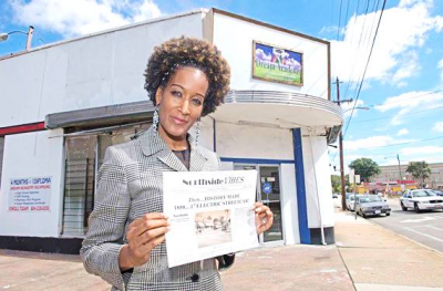 Northside Vibes by Flavor News CEO Deone McWilliams proudly holds one of her first issues after she started publishing.